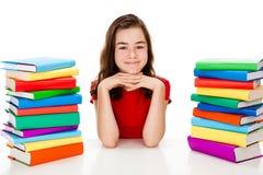 Menina que faz trabalhos de casa Imagem de Stock