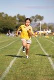 Menina que funciona na raça Fotos de Stock Royalty Free