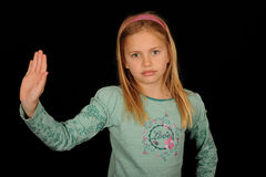 Menina que gesticula o batente com mão Imagens de Stock Royalty Free