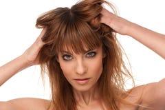 Menina que gesticula o cuidado de cabelo Fotos de Stock