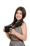 Menina que guarda a câmera do dslr Imagens de Stock
