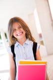 Menina que guarda livros Fotos de Stock Royalty Free