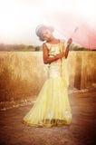 Menina que guarda o guarda-chuva no vestido Imagens de Stock Royalty Free