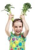 Menina que guarda os brócolis dois Imagem de Stock