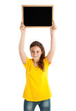 Menina que guarda a placa Imagens de Stock
