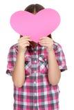 Menina que guarda um coração de papel Fotos de Stock