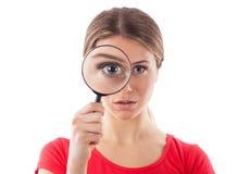 Menina que guarda uma lupa Imagem de Stock