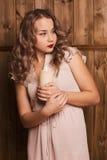 Menina que guarda uma vela Imagens de Stock