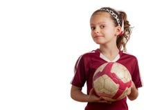 Menina que guardara a bola de futebol fotografia de stock