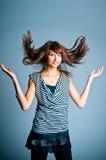 A menina que joga com o cabelo Foto de Stock