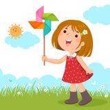 Menina que joga com um brinquedo colorido do moinho de vento ilustração stock