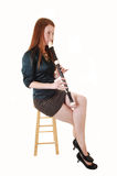 Menina que joga a flauta. Imagem de Stock Royalty Free