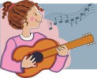 Menina que joga a guitarra. Foto de Stock