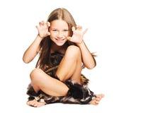 Menina que joga no homem primitivo Imagens de Stock Royalty Free