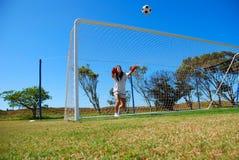 Menina que joga o futebol foto de stock royalty free