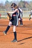 Menina que joga o softball Imagem de Stock Royalty Free