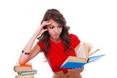 Menina que lê livro interessante Foto de Stock