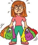 Menina que leva desenhos animados pesados dos sacos de compras Fotos de Stock Royalty Free