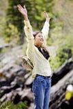 Menina que levanta as mãos no elogio Imagem de Stock