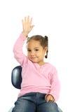 Menina que levanta sua mão Imagens de Stock Royalty Free