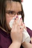 Menina que limpa o nariz Imagens de Stock Royalty Free