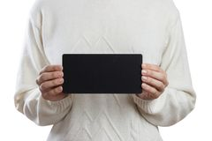 Menina que mantém um quadro-negro pequeno isolado no fundo branco Imagem de Stock