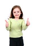 Menina que mantem dois polegares Fotografia de Stock