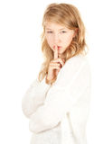 Menina que mantem-se silenciosa Fotografia de Stock