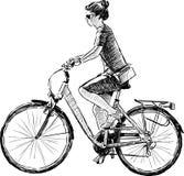 Menina que monta uma bicicleta Imagem de Stock Royalty Free