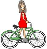 Menina que monta uma bicicleta Foto de Stock