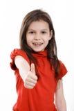 Menina que mostra o polegar imagem de stock