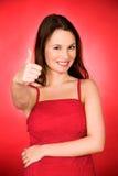 Menina que mostra os polegares acima Fotos de Stock