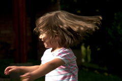 Menina que move a cabeça Imagens de Stock
