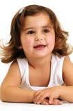 Menina que olha e que sorri enquanto inclinando-se sobre Imagem de Stock