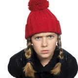 Menina que olha irritada Foto de Stock