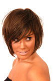 Menina que olha sobre seu ombro Foto de Stock Royalty Free