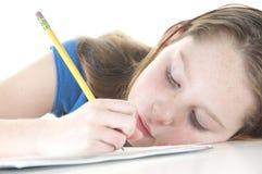 Menina que olha tired com trabalhos de casa Imagens de Stock Royalty Free