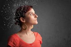menina que pensa com ícones abstratos em sua cabeça Fotos de Stock