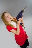 Menina que prende a broca elétrica foto de stock royalty free