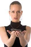 Menina que prende o telefone móvel Fotografia de Stock Royalty Free