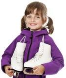 Menina que prende patins de gelo foto de stock royalty free