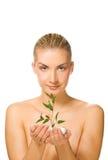 Menina que prende a planta nova Imagem de Stock Royalty Free