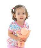 Menina que prende um bebê Imagem de Stock