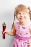 Menina que prende um lápis Fotografia de Stock