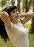 Menina que relaxa no parque Imagem de Stock Royalty Free