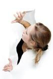 Menina que sai do furo no papel Imagem de Stock