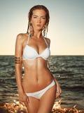 Menina que sai do mar Imagens de Stock Royalty Free