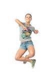 A menina que salta para a alegria Imagens de Stock Royalty Free