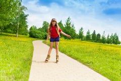 Menina que scatting no parque Imagem de Stock