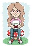 Menina que senta-se em um cogumelo que joga o jogo de vídeo Foto de Stock Royalty Free